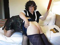Transvestite maid spanking